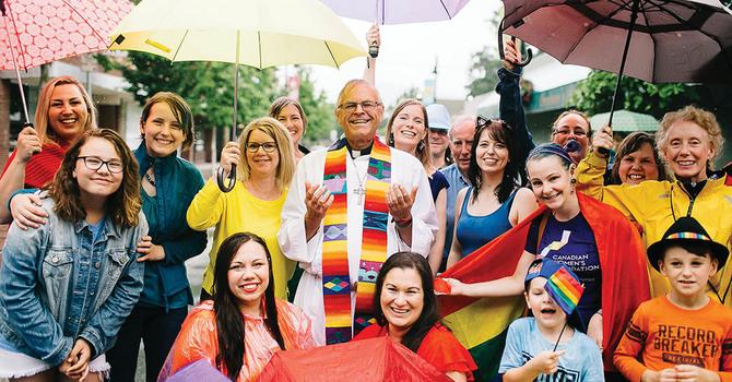 D of NW Priest Participates in Rainbow Photo