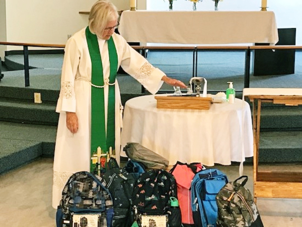 Holy Trinity Riverbend Offers Backpacks and Blessings