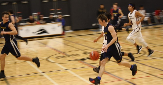 Another win for senior boys basketball image